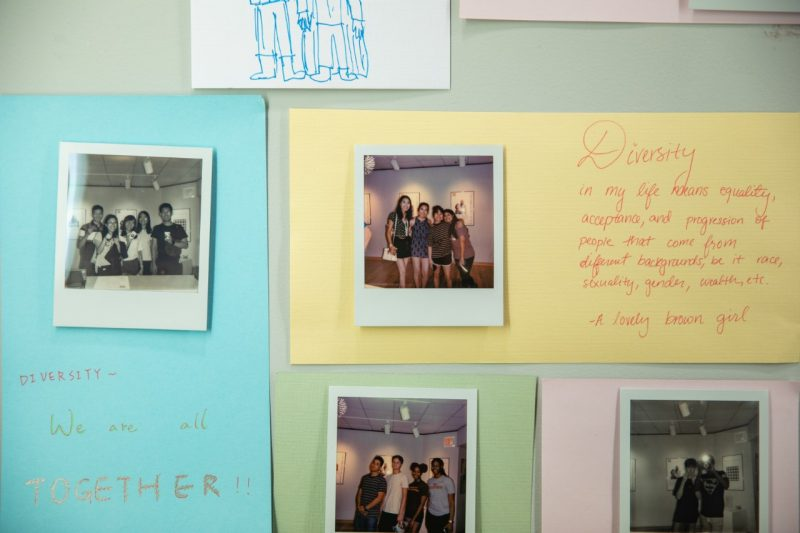 Polaroid photos and handwritten reflections on diversity.