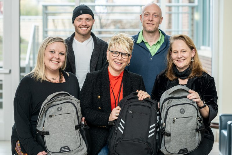 Group of 5 people with backpacks