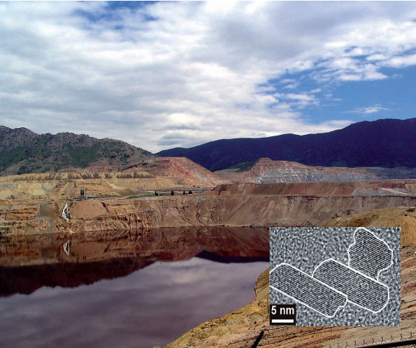 The Berkeley Pit in Butte, Mont. Surface waters that drain this area contain heavy metal contaminated mineral nanoparticles. Such environmental nanoparticles contribute to the transport of these metals up to 500 kilometers downstream. Inset: Mineral nanoparticles found in the Clark Fork River.