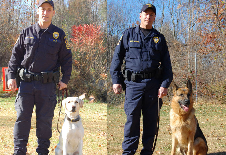 Pictured left to right are, Officer Larry Wooddell, Boomer, Officer Keith Weaver, and Boris.