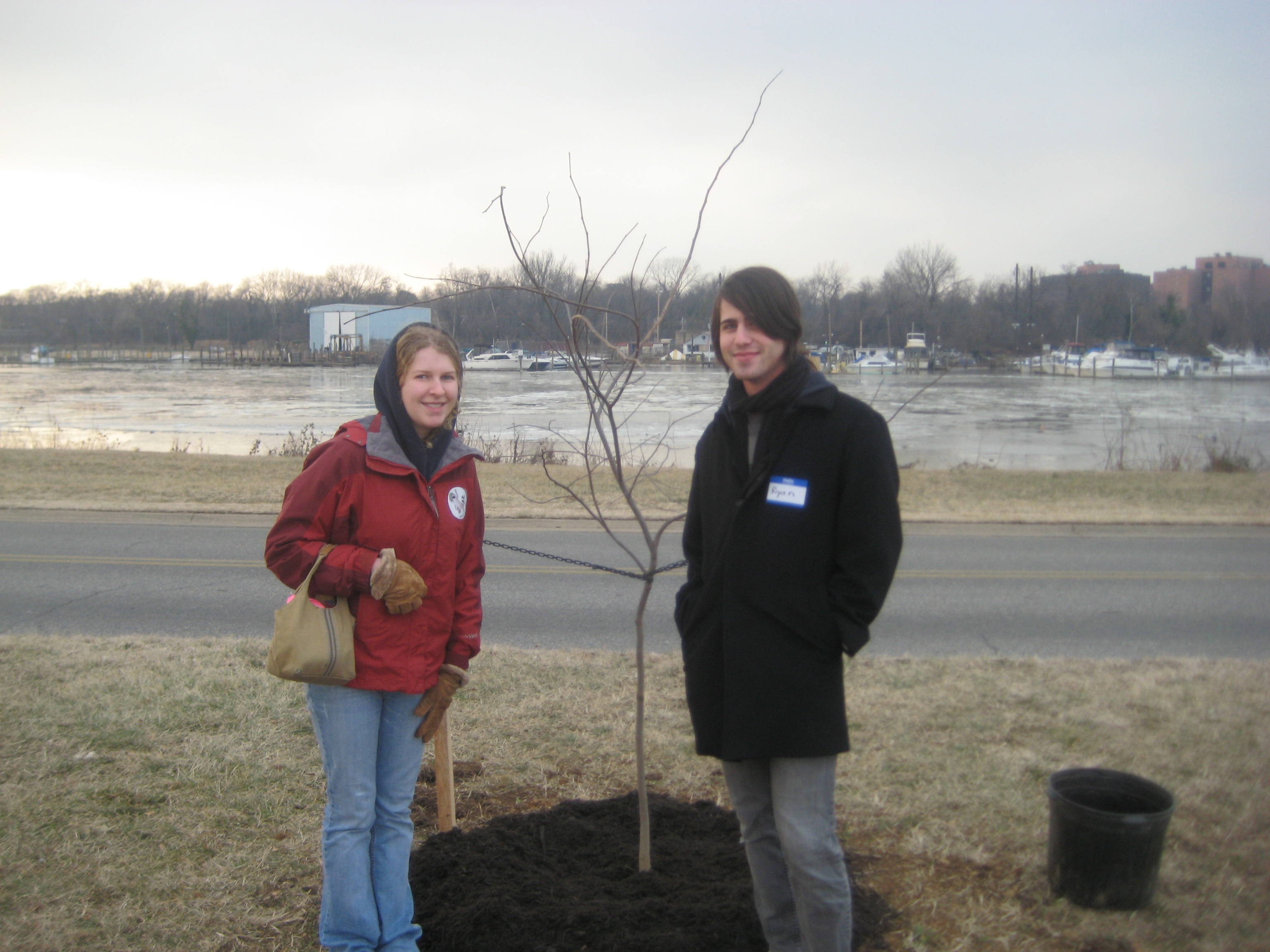 Sara Murrill (left), a College of Natural Resources forestry graduate student at Virginia Tech and Virginia Tech aerospace alumnus Ryan Wagoner of Fairfax, Va., helped a thousand kids plant 44 trees at Anacostia National Park in Washington D.C., in honor of President Barack Obama.