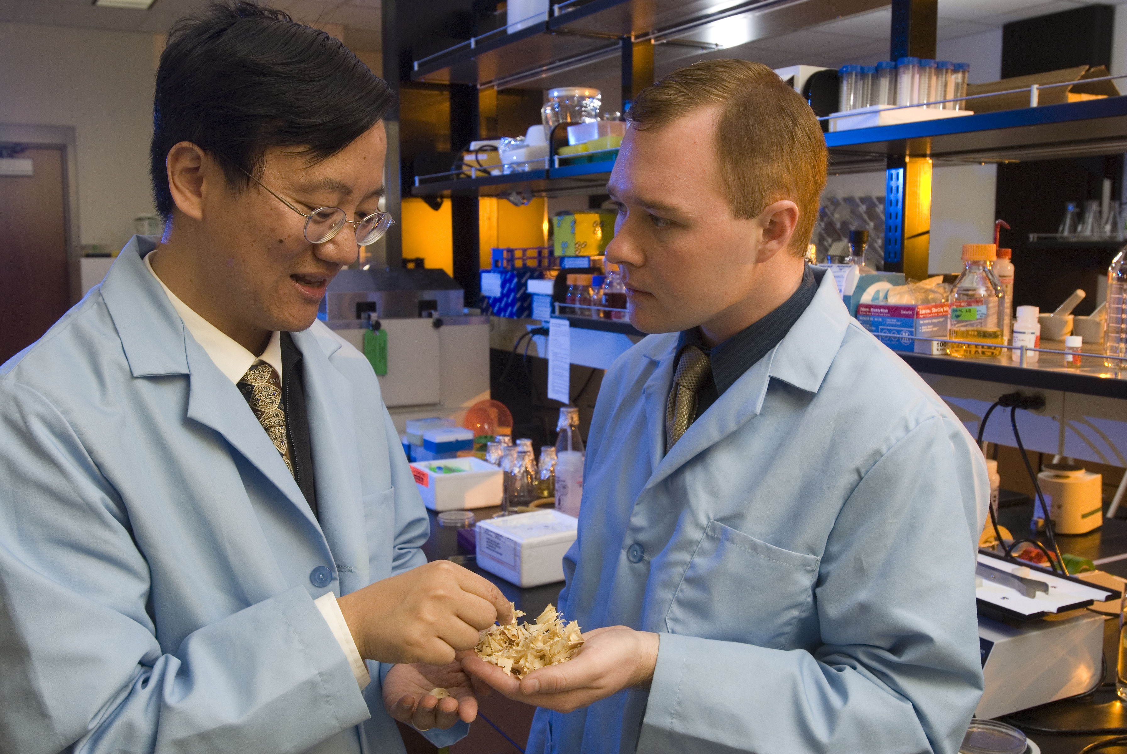 Percival Zhang (left) discusses conversion of biomass to energy with Geoff Moxley, who recently received his master of science degree in biological systems engineering from Virginia Tech.