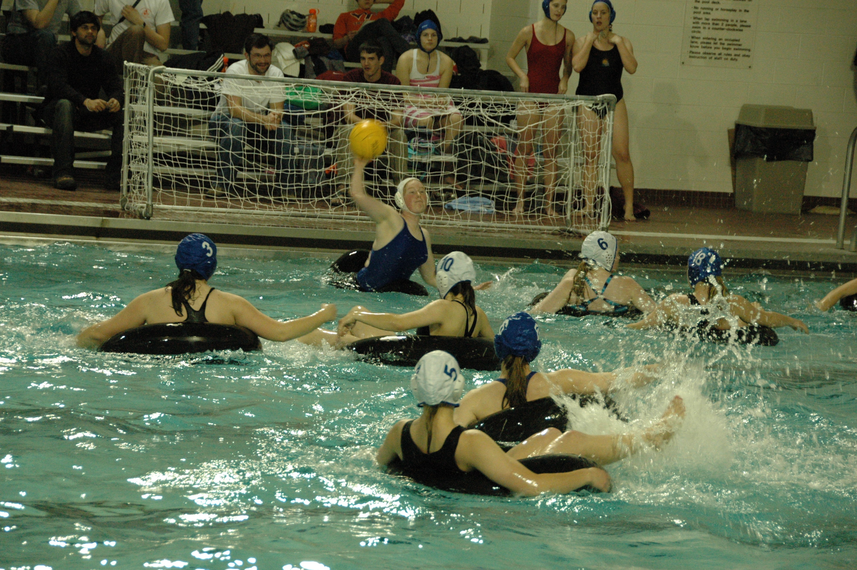 Students play innertube water polo