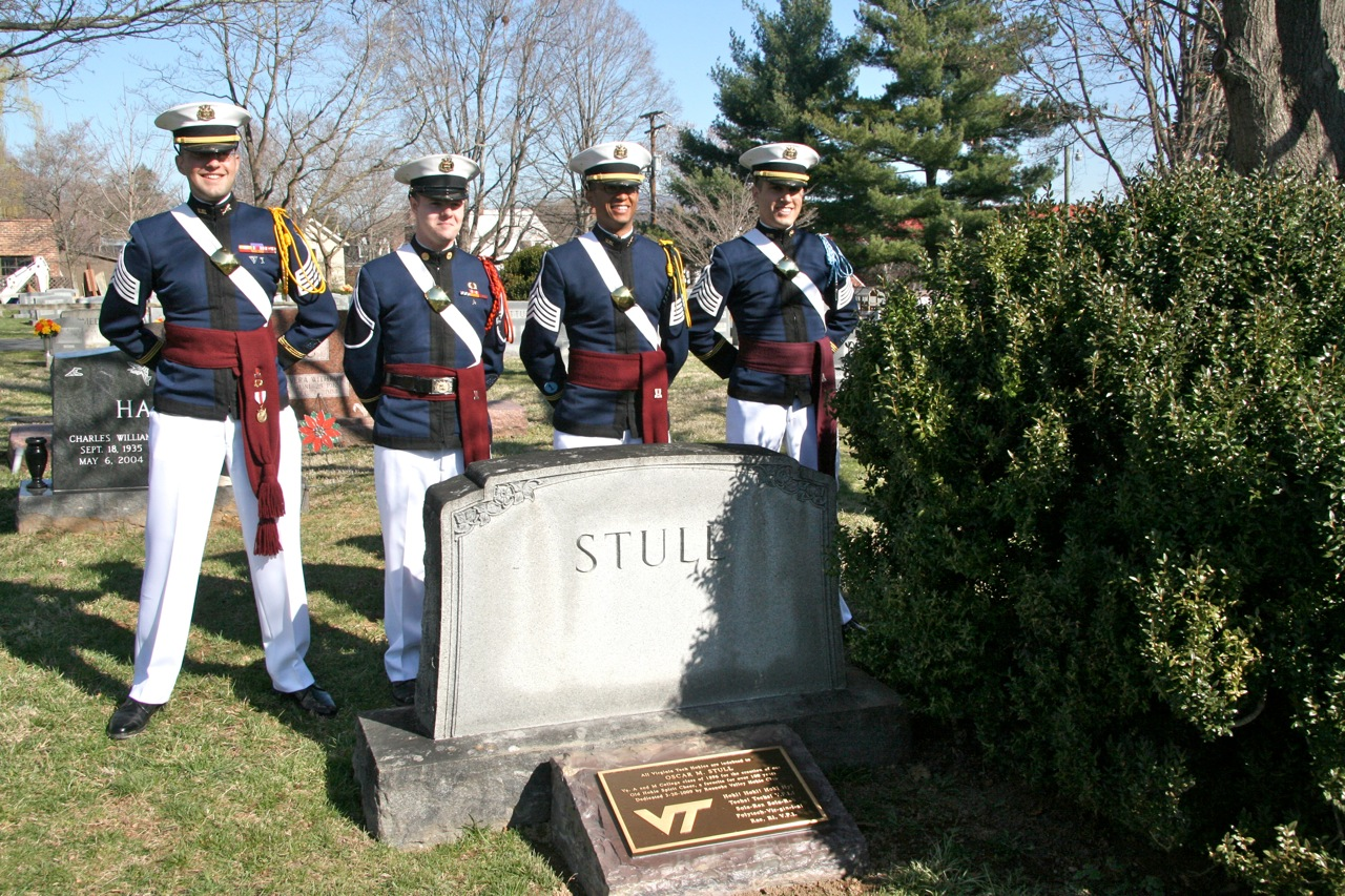 Cadets stand with the memorial stone and plaque.