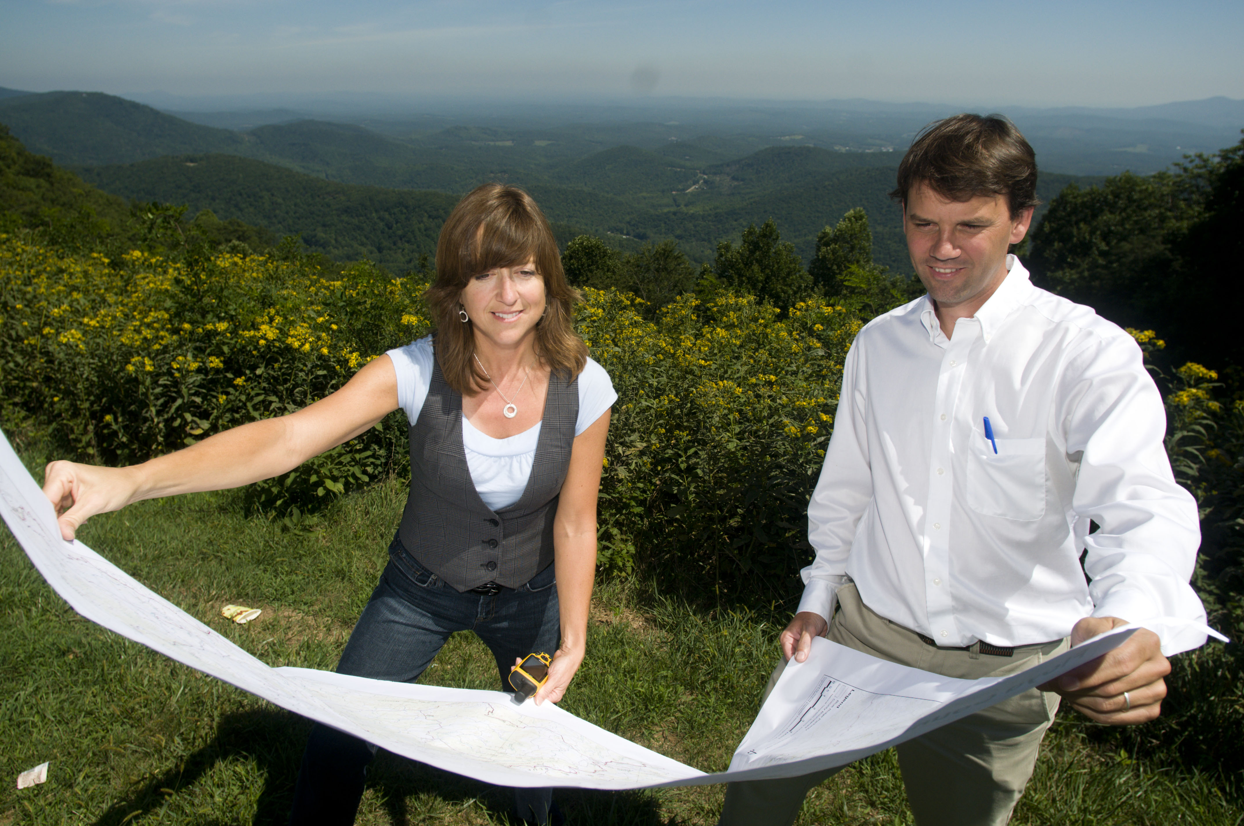 Nancy McGehee (left) and John McGee review a survey of the Rocky Knob area of the Blue Ridge Parkway.
