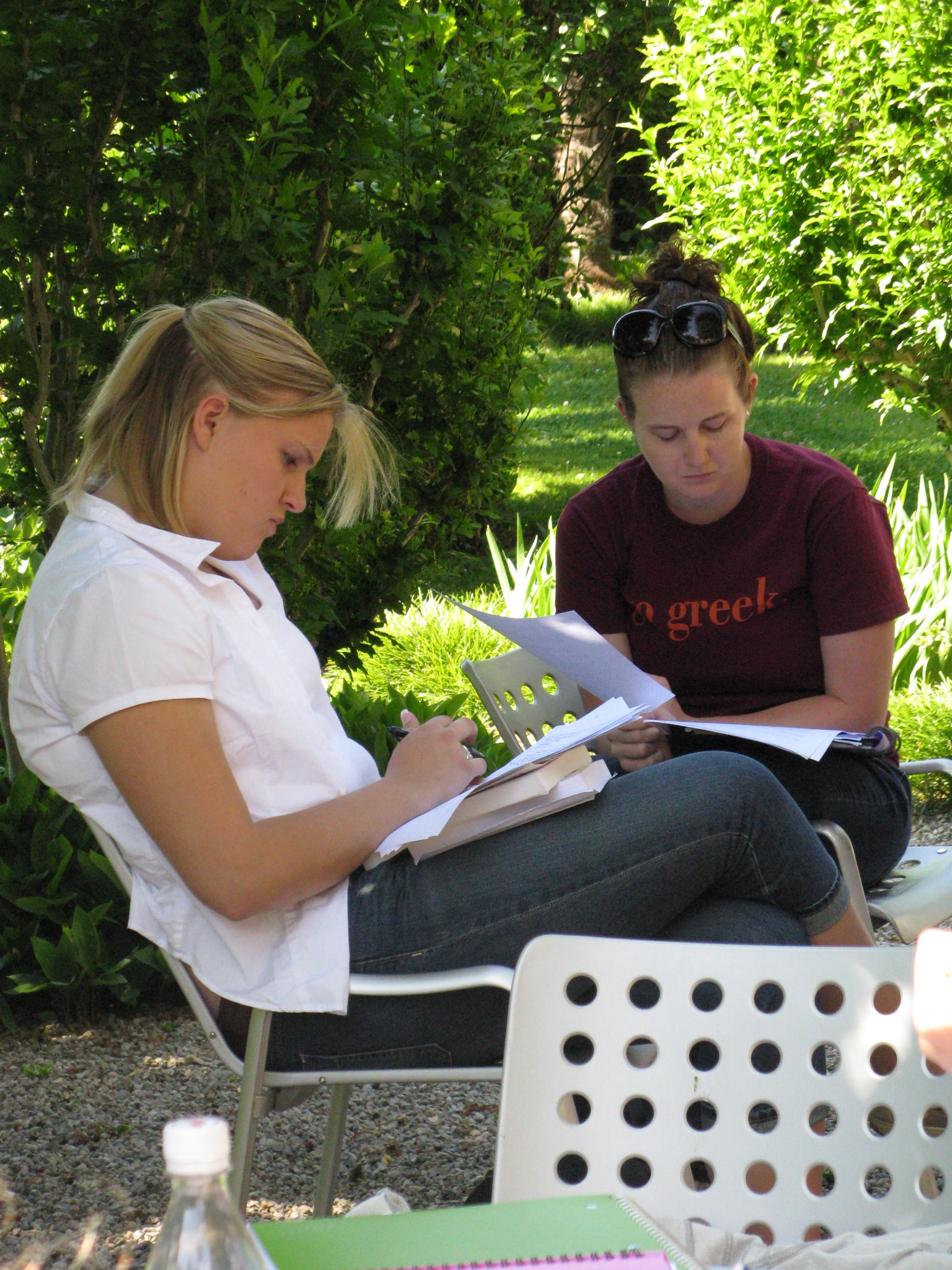 Junior communications major Allison Postlethwait (left), an Honors student from Northborough, Mass., and senior communications major Amber Finlay, a senior from Lincoln, Va., work on articles for Maderni in the garden outside of Villa Maderni.