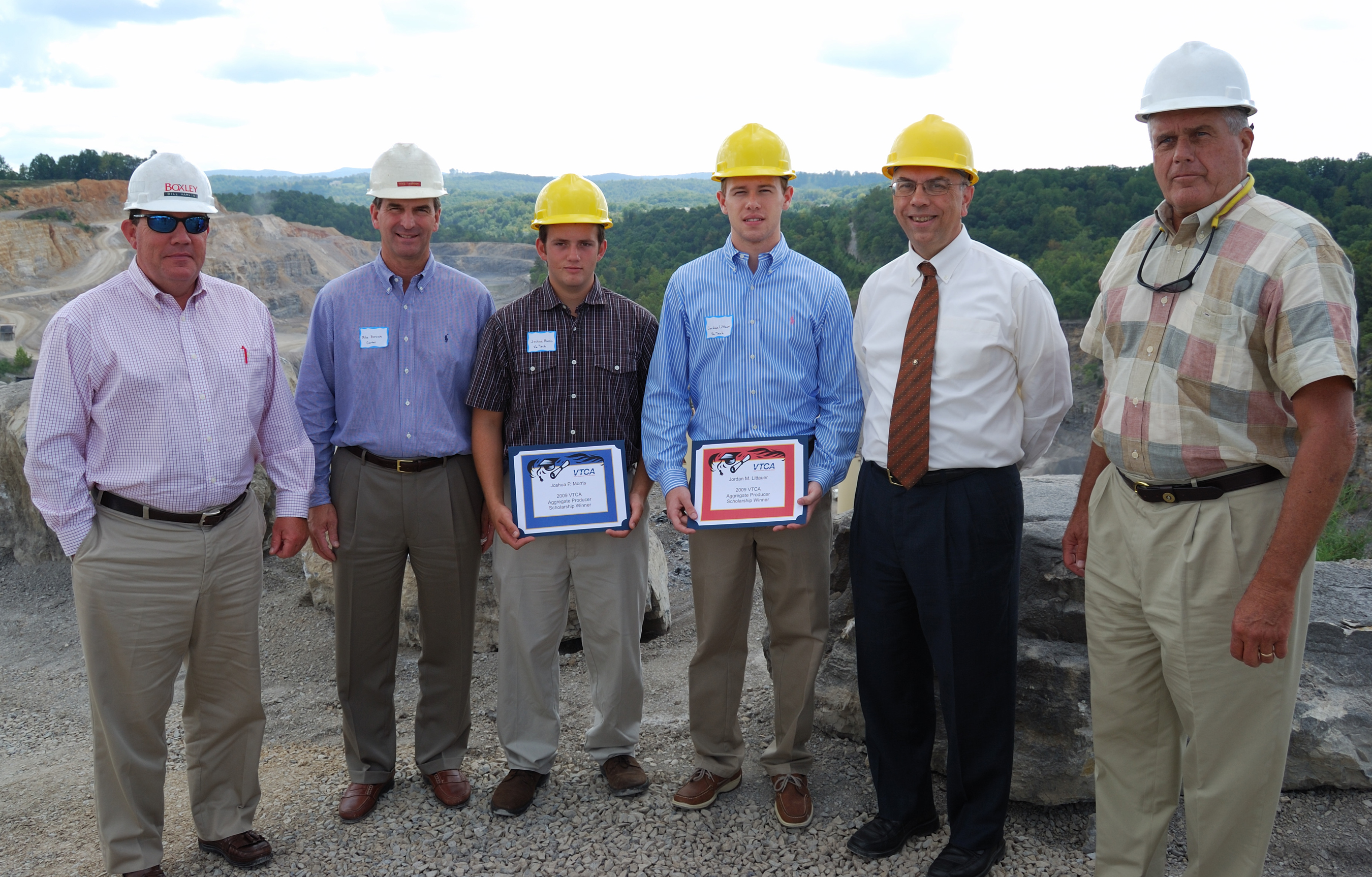 (Left to right)Bill Hamlin, Boxley Materials Co.; Mike Harcum, Carter Machinery; Joshua Morris; Jordan Littauer; Greg Adel, professor and mining and minerals engineering department chairman at Virginia Tech; and M.J. O'Brien Jr., president of Salem Stone. Hamlin, Harcum and O'Brien are members of the Virginia Transportation Construction Alliance, which awarded Morris and Littauer scholarships.