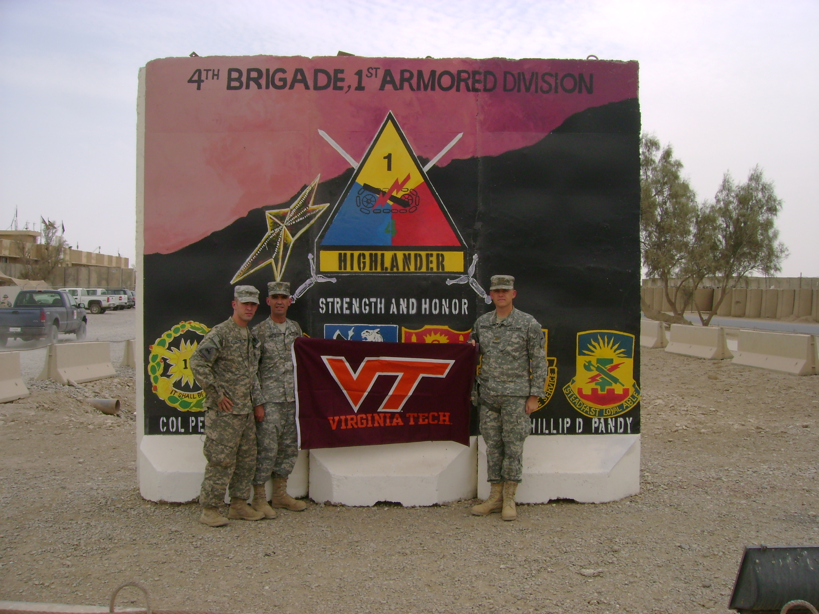 Hogeboom (right) with brothers 1st Lt. Antonio Pazos, member of Virginia Tech Corps of Cadets Class of 2007 who majored in civil engineering in the College of Engineering (left), and Maj. Rafael Pazos, member of Virginia Tech Corps of Cadets Class of 1993 who majored in mechanical engineering also in the College of Engineering (center) pictured outside the 4th Brigade Combat Team, 1st Armored Division Headquarters, COB Adder, Iraq.