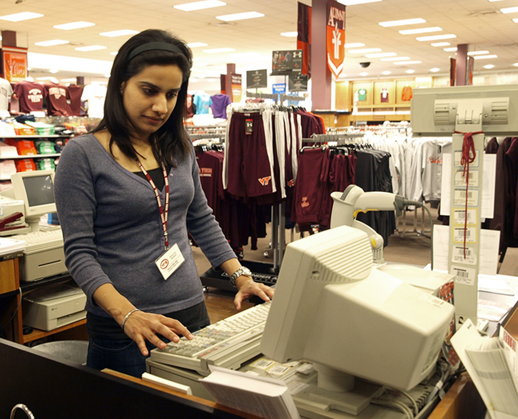 Amijot Bajwa of Dehli, India, a Volume Two bookstore employee who is working on her master's in business administration in the Pamplin College of Business, takes donations from customers for Hokies United™.
