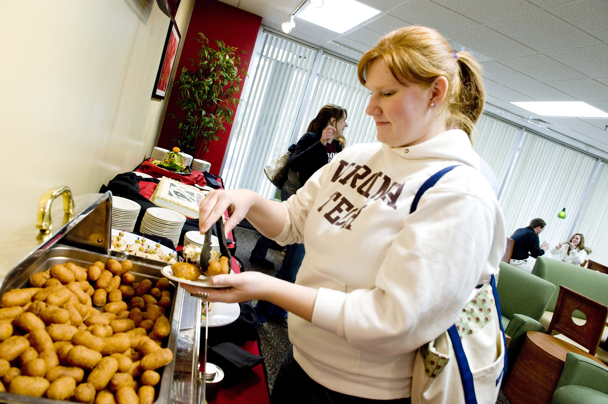 A student tries samples of food from the new DXpress menu.