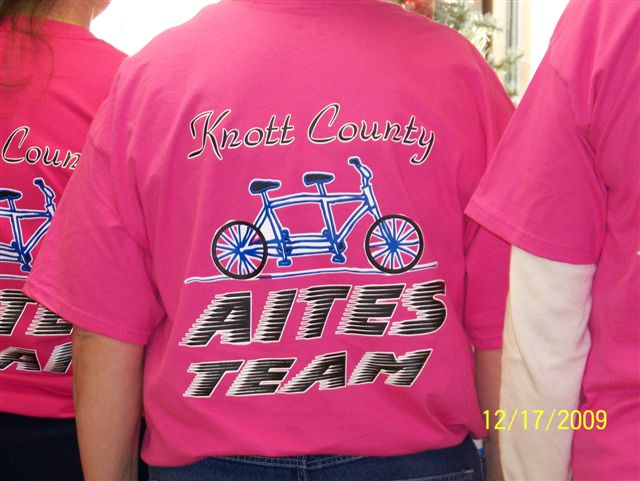 The tandem bike metaphor is displayed on the back of the Knott County, Ky., community cohort team T-shirt.