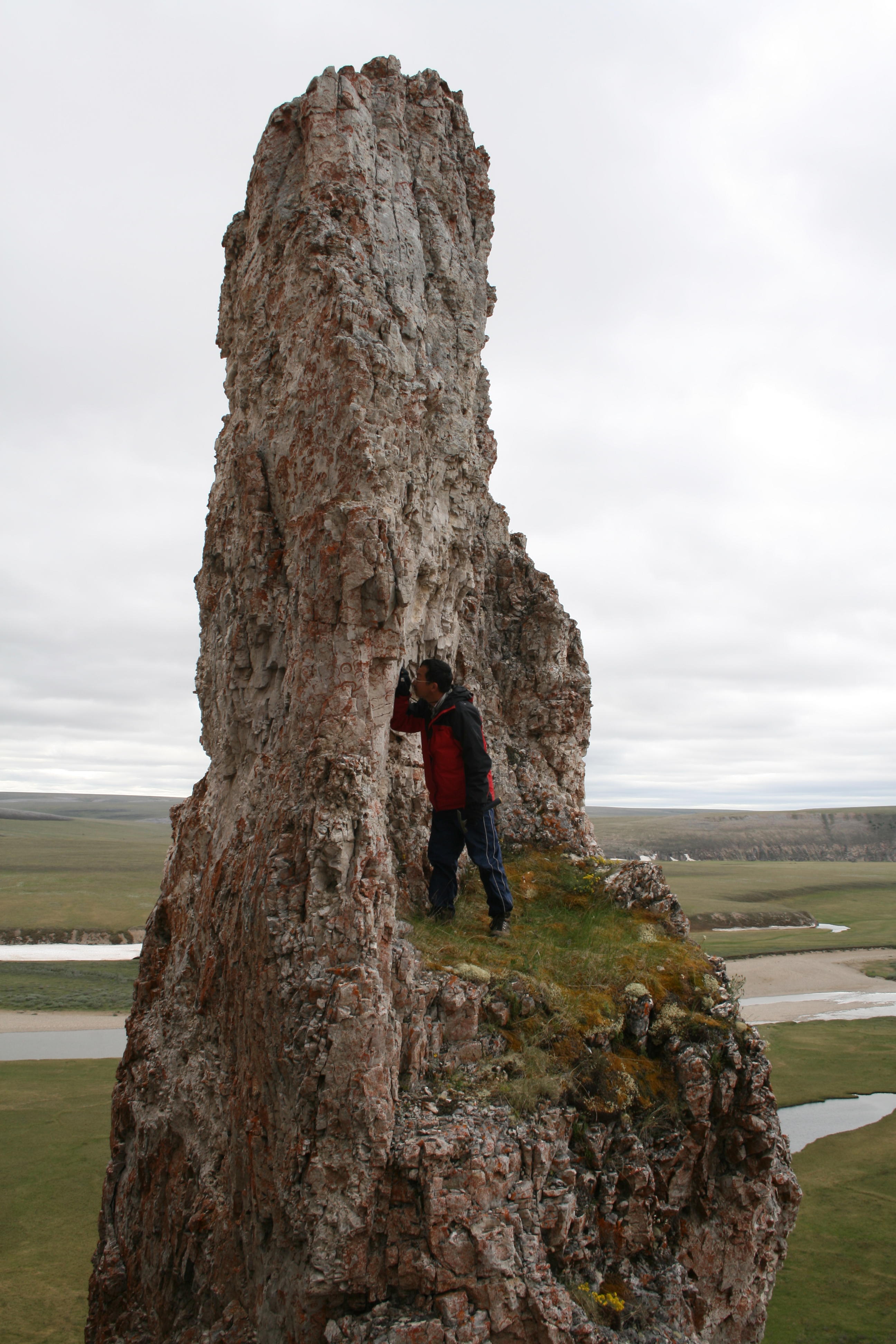 Except for formations such as this dolostone column of the Turkut Formation near the Khorbusonka River, the Siberian Arctic is flat. During his exploration of such formations, Virginia Tech geobiologist Shuhai Xiao and collaborators found many fossils in these ancient rocks. Xiao has received a Guggenheim fellowship to support his research.