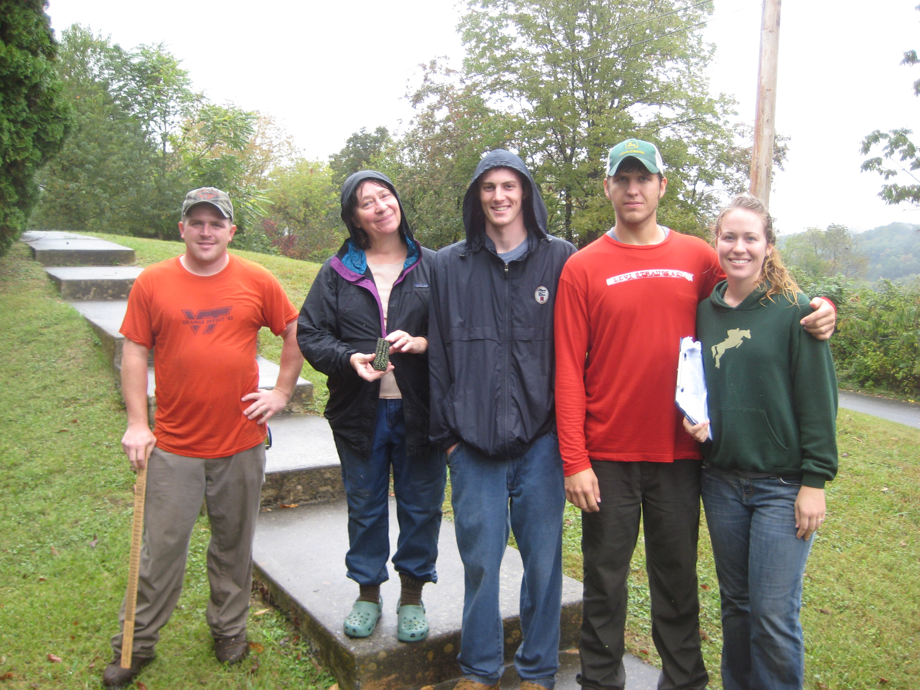 Landowner Betty Bailey (second from left) welcomed Virginia Tech service-learning students (left to right) J.B. Snelson, Chris Mernin, Spencer Blankenship, and Bonnie Lawrie on a rainy day in late September to identify possibilities for planting trees to reduce erosion along stream banks on her property.