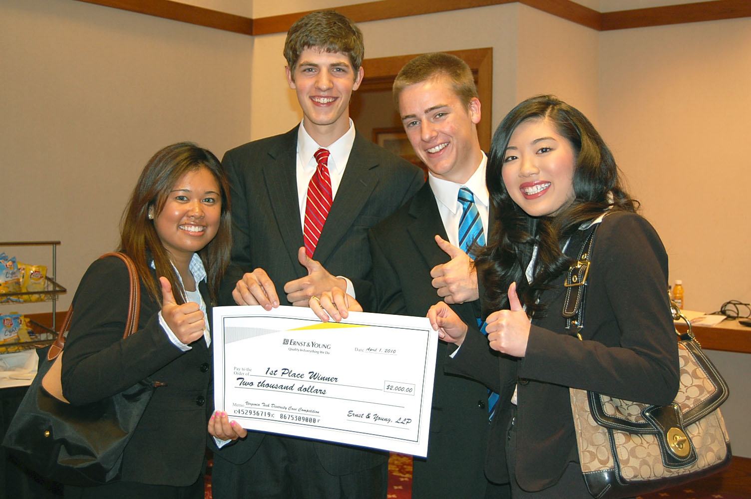 Diversity case competition winners, from left to right are Sunny Senedara, Sam Banks, Ian Hamre, and Denise Kee.
