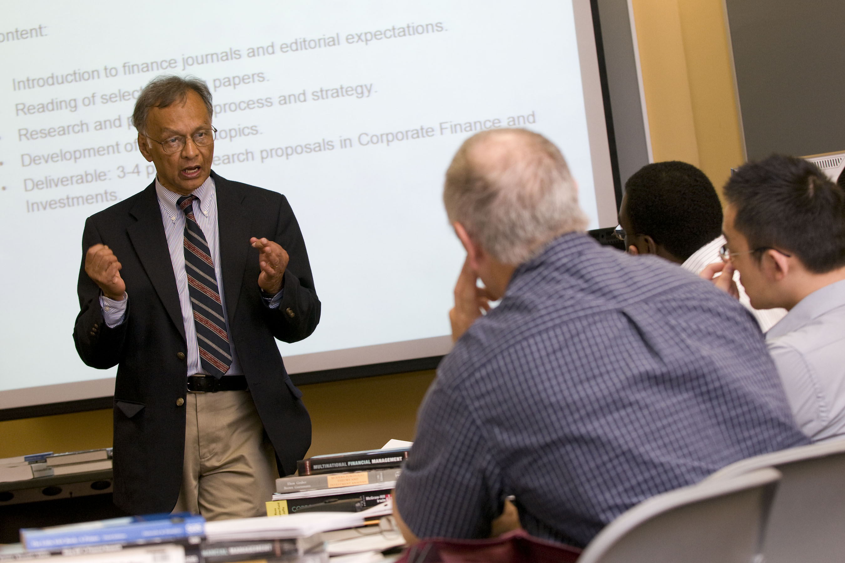 Finance professor Dilip Shome leads a bridge program class in finance