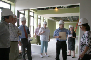 Administrators from across the university tour the future home of the new residential colleges during the Ambler Johnston Hall renovation.