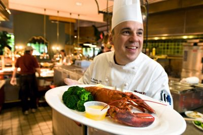 Executive Chef Mark Bratton serves lobster at West End Market