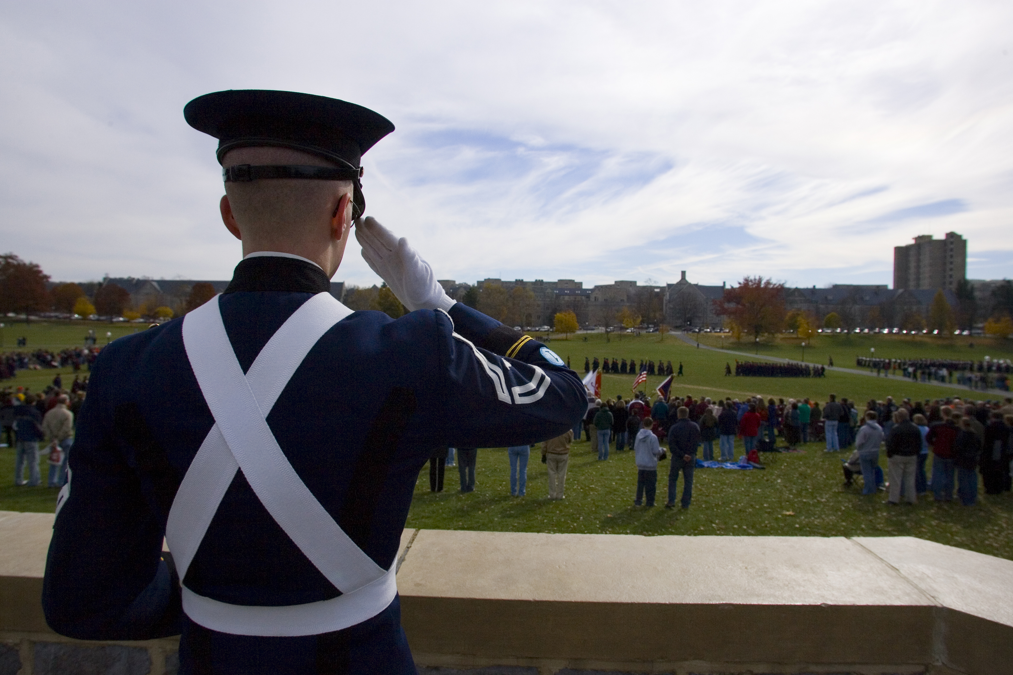 A cadet watches the corps perform the pass in review.