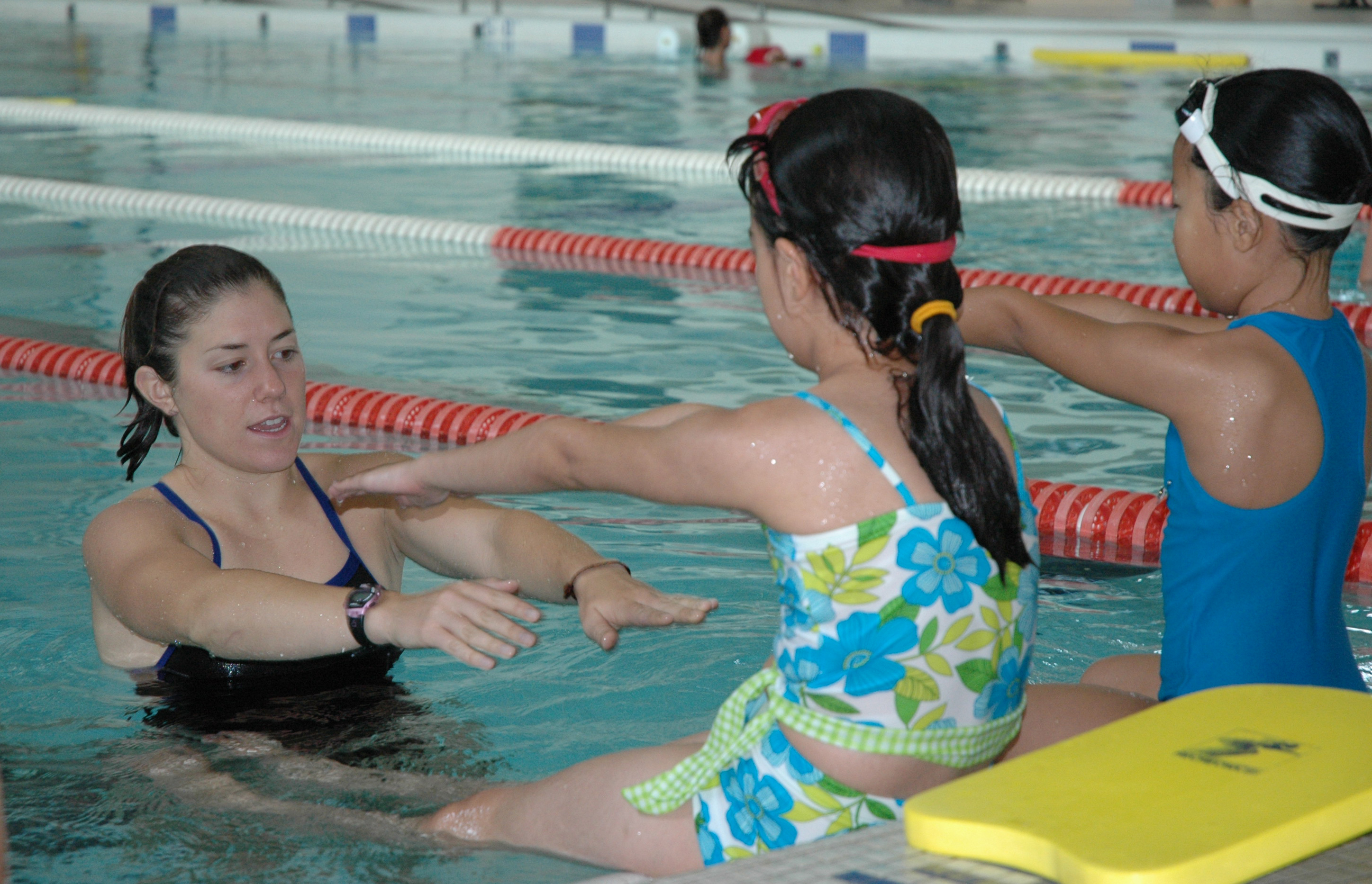 Community members learn swim techniques.