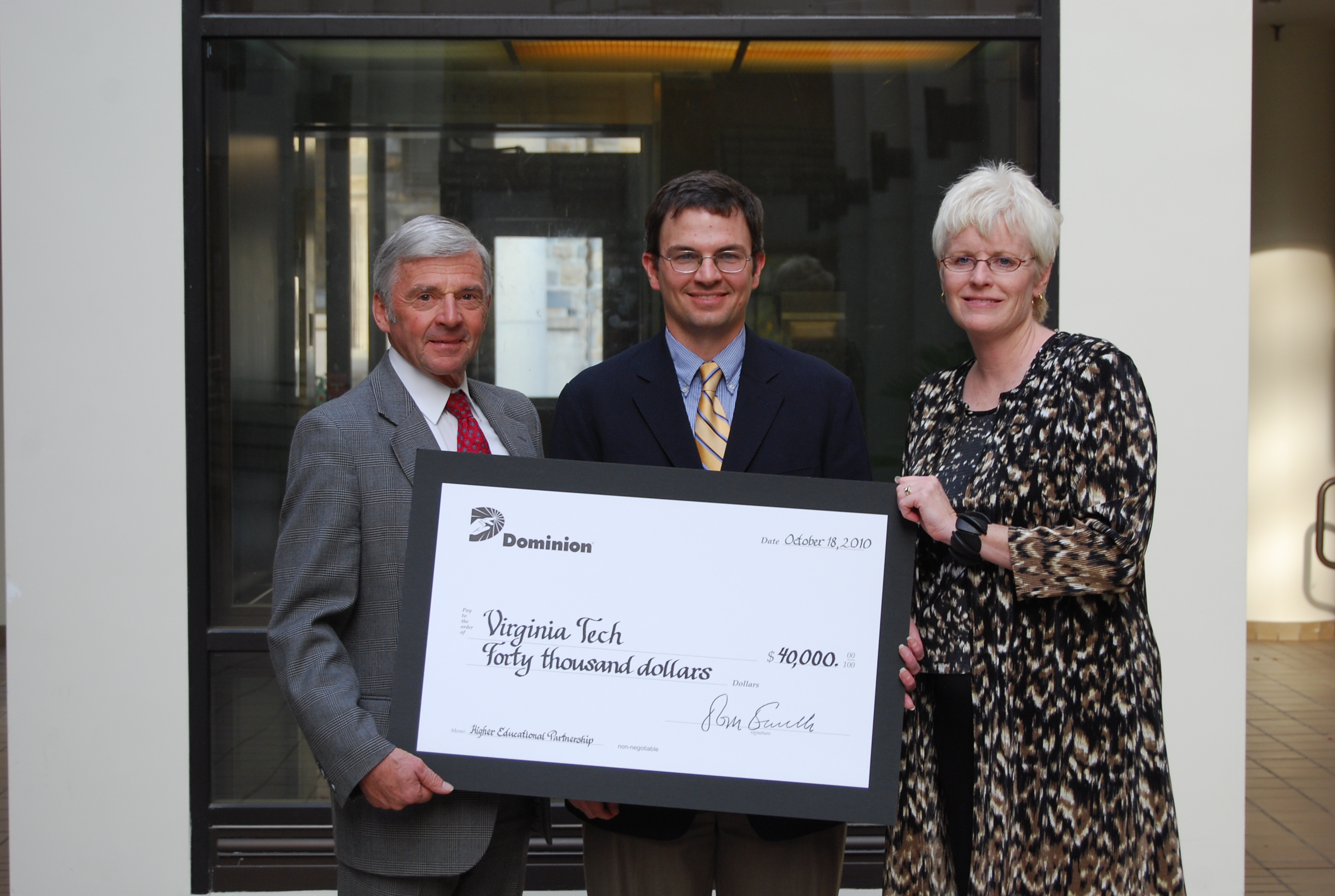 Pamplin Dean Richard E. Sorensen, Pamplin undergraduate career services director Stuart Mease, and Dominion philanthropy manager Cindy Balderson in Pamplin Hall