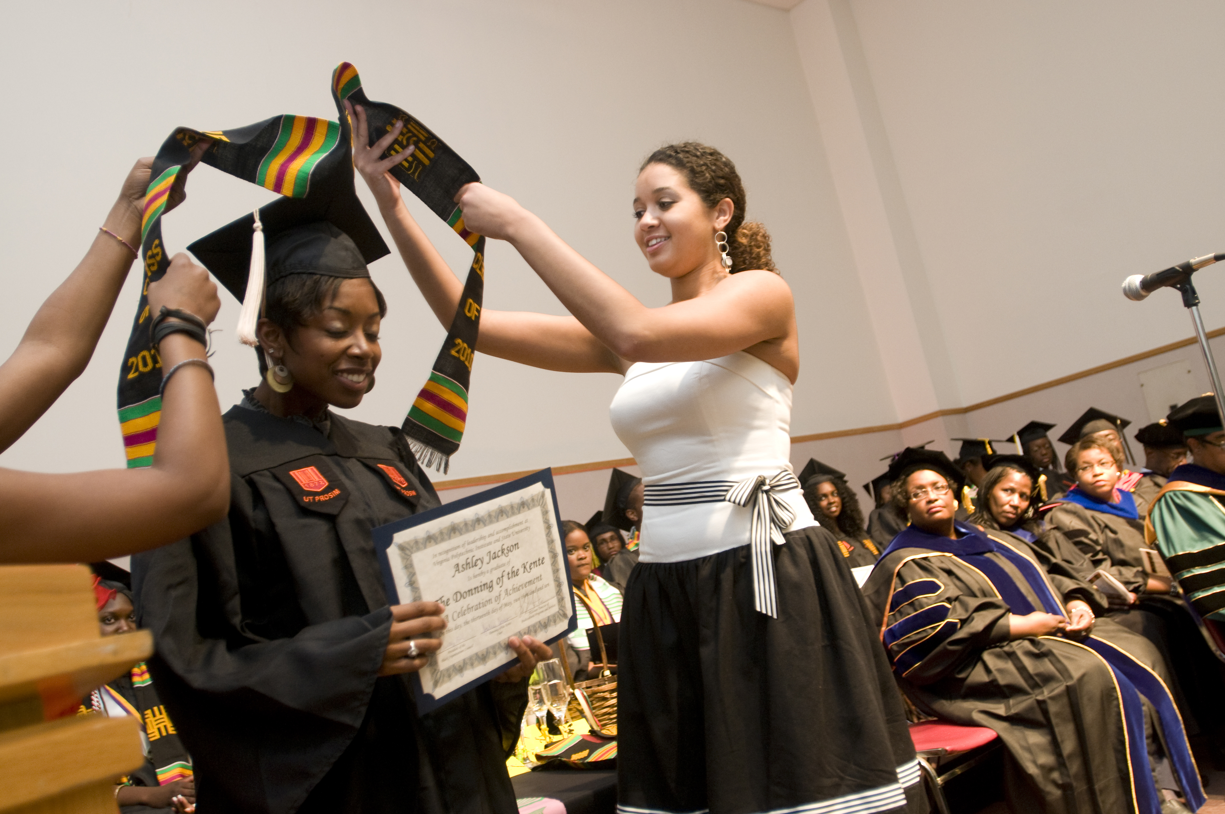 A graduate receives her stole at the spring 2010 ceremony.