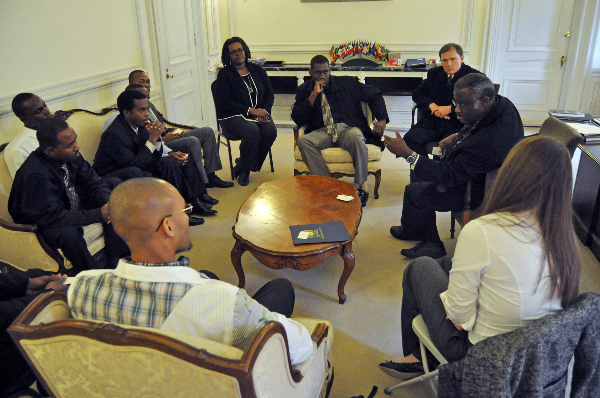 Haitian Ambassador Louis Harold Joseph answers interns' questions during a visit to Washington, D.C.