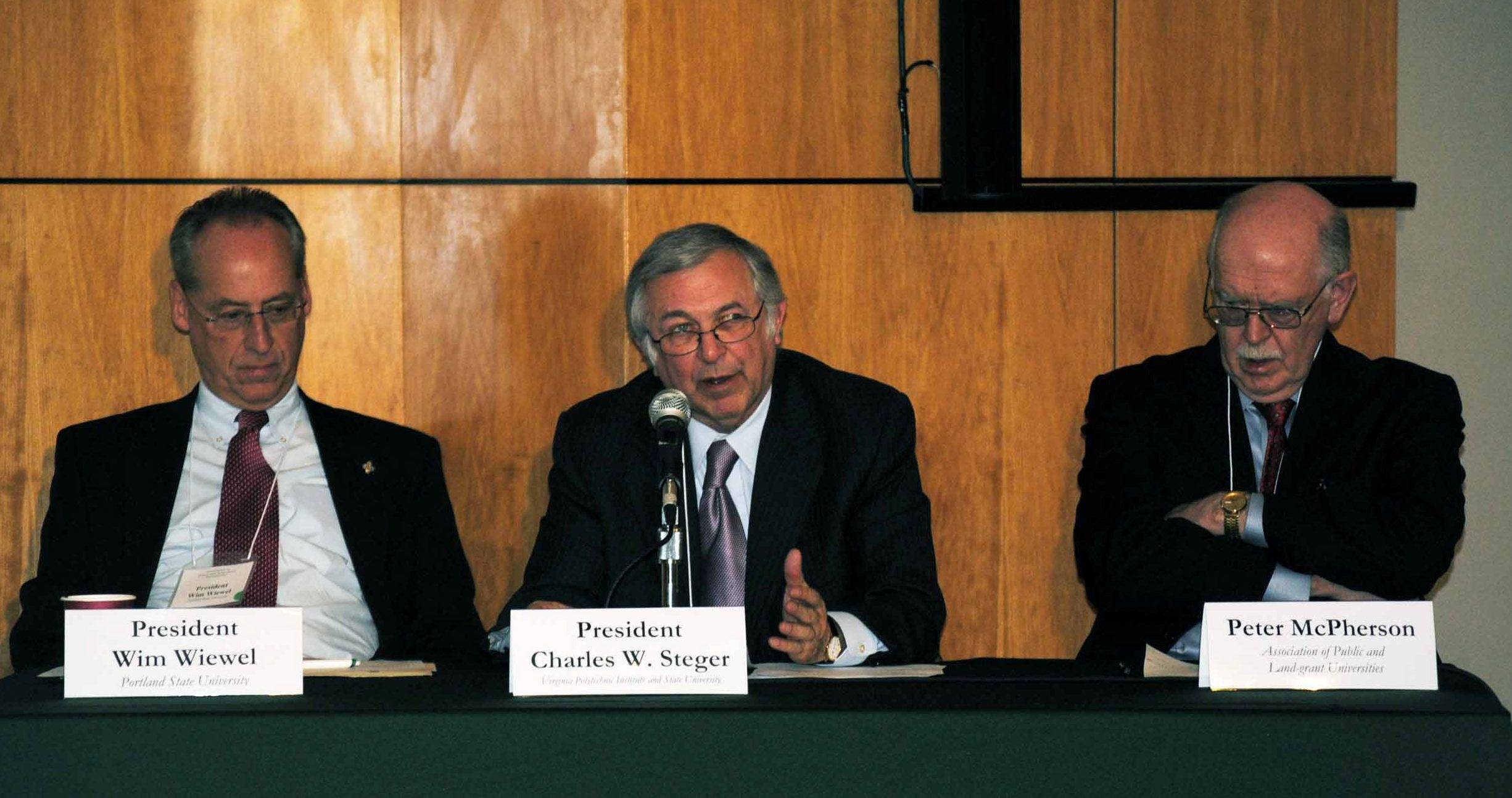 Charles Steger, Wim Wiewel and Peter McPherson speak during forum