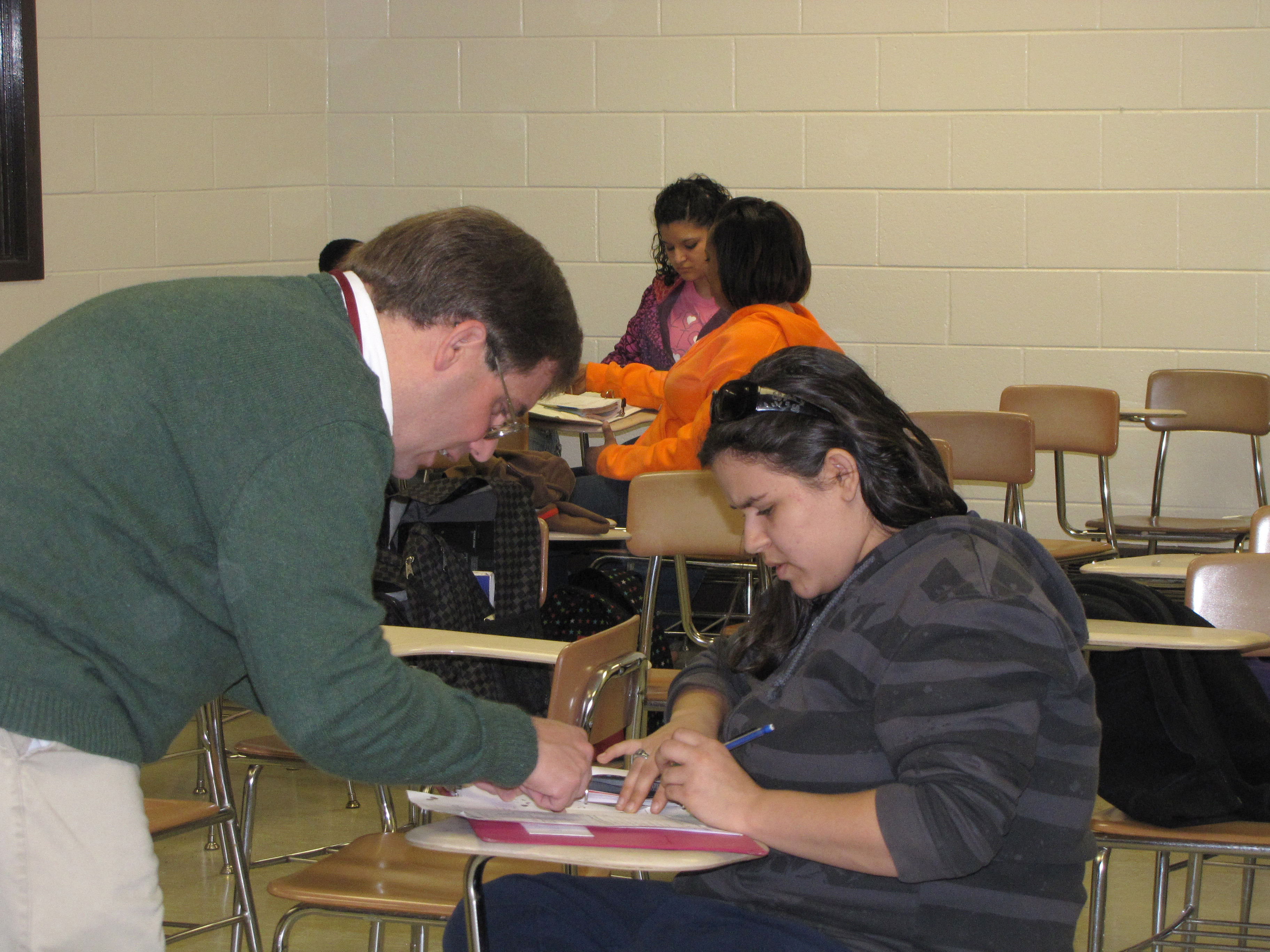 A tutor counsels a student at an Upward Bound session.