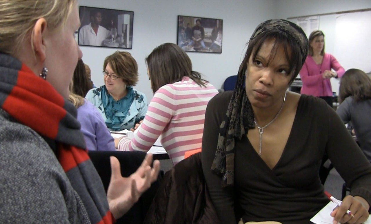 In a workshop sponsored by the Virginia Tech Women's Center, Latanya Walker (right) of Upward Bound/Talent Search practices active listening during a mock coaching session.