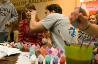 Students paint children's faces at Winterfest 2010.