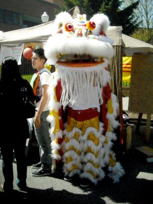 A colorful Chinese dragon costume on display at the street fair.