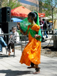 A young dancer performs at the International Street Fair in 2010.