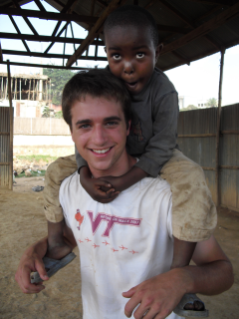 Matt Capelli, a graduate student in civil engineering in the College of Engineering as well as the Pamplin College of Business MBA program, with a child