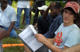 Nick Mason (right), of Richmond, Va., who is graduating this month with a degree in civil engineering, holds a planning session with community members in Ti Péligre, Haiti.