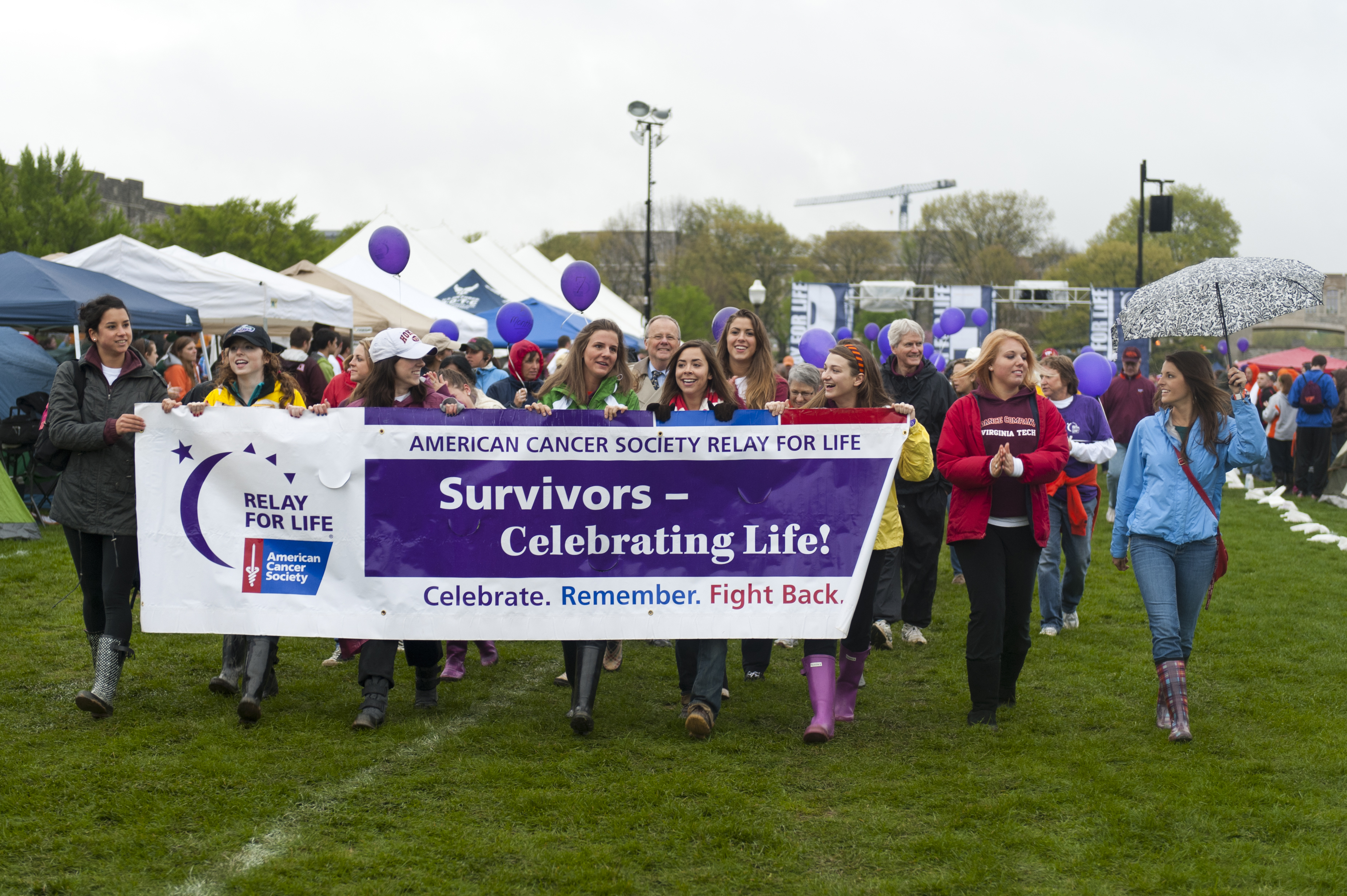 Group carries the cancer survivors' banner around the Relay For Life track