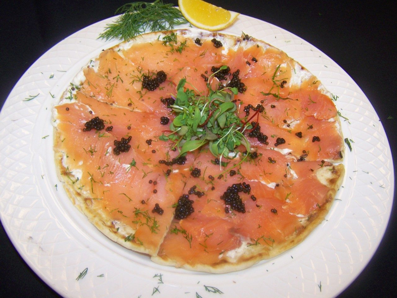 Preston's smoked salmon flatbread features fresh dill from the garden.