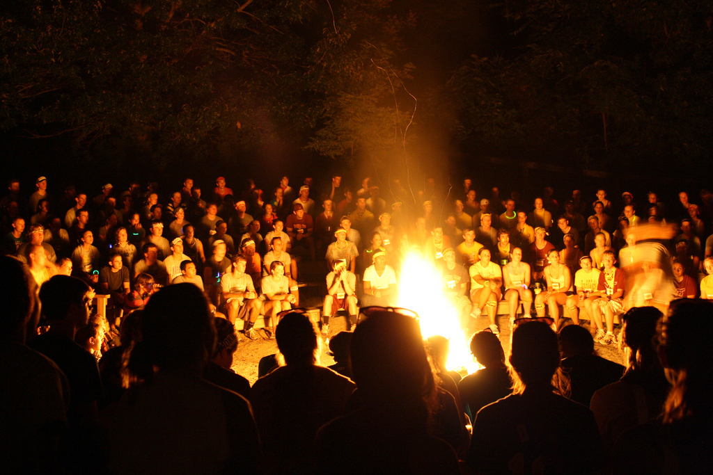 Students gather around a bonfire at Hokie Camp.