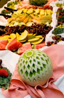 Specialty displays, like intricately carved melons, were presented as Dining Services would for a high-end catering event, which dressed up the dining center to complement the theme.