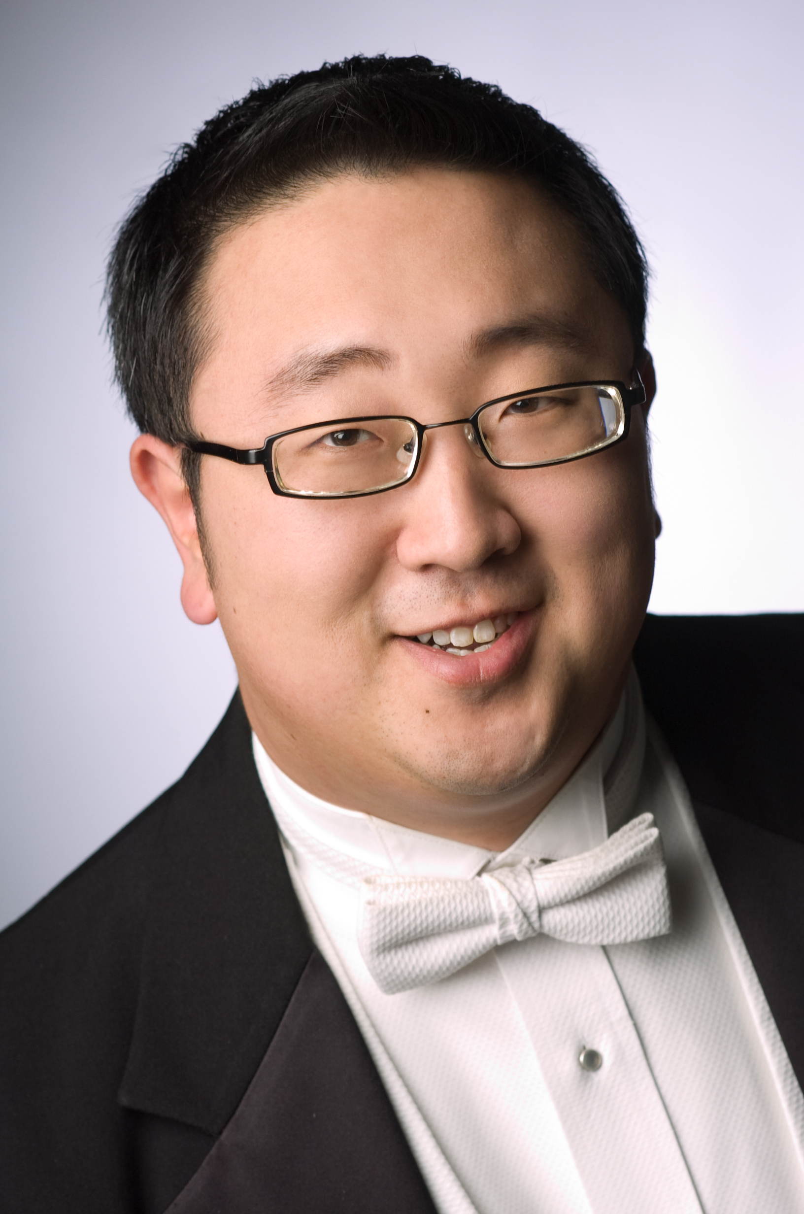 Travis J. Cross, conductor