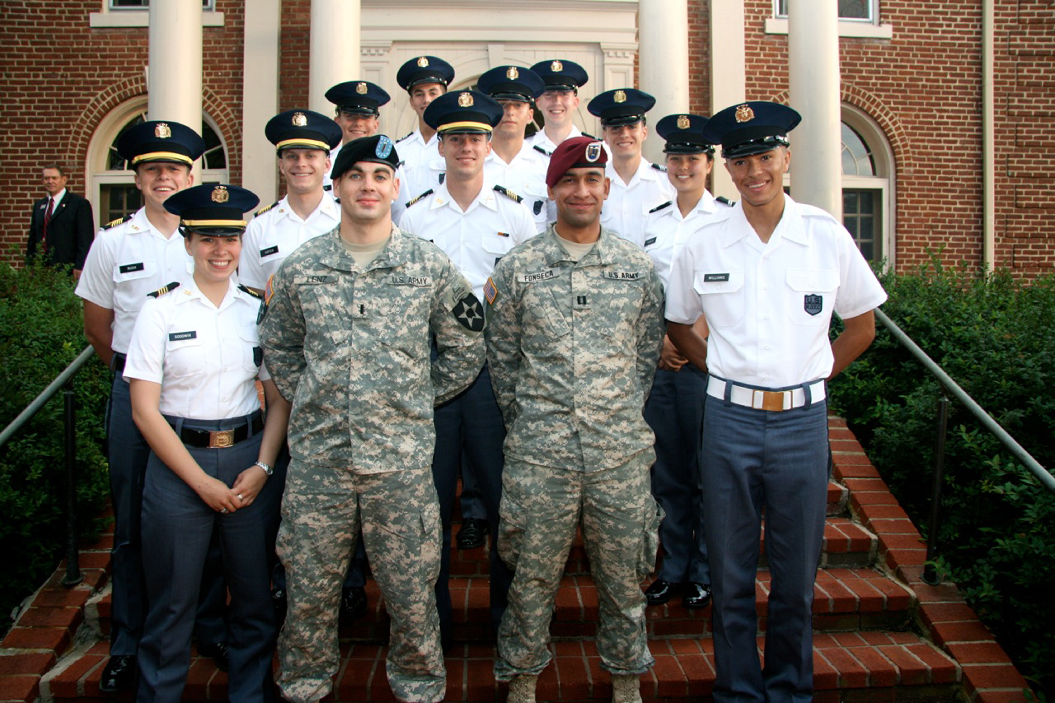 1st Lt. Thomas Lenz (center, left), U.S. Army, Virginia Tech Corps of Cadets Class of 2008 and Capt. Roberto Fonseca (center, right), U.S. Army, Virginia Tech Corps of Cadets Class of 2004, previous Gunfighter panelists standing with members of the Corps of Cadets
