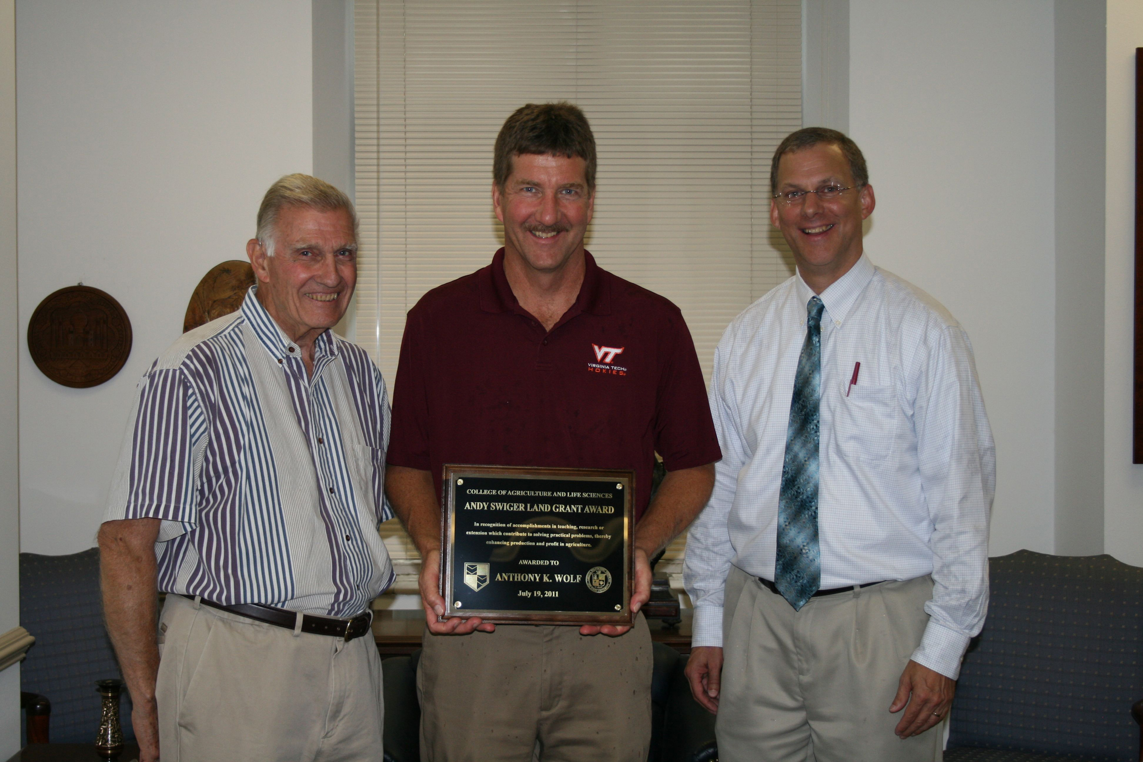 Tony Wolf (center), professor of horticulture and director of the Alson H. Smith Jr. AREC, receives the 2011 Swiger Land-Grant Award from Dean Emeritus Andy Swiger, (left) and Alan Grant, dean.