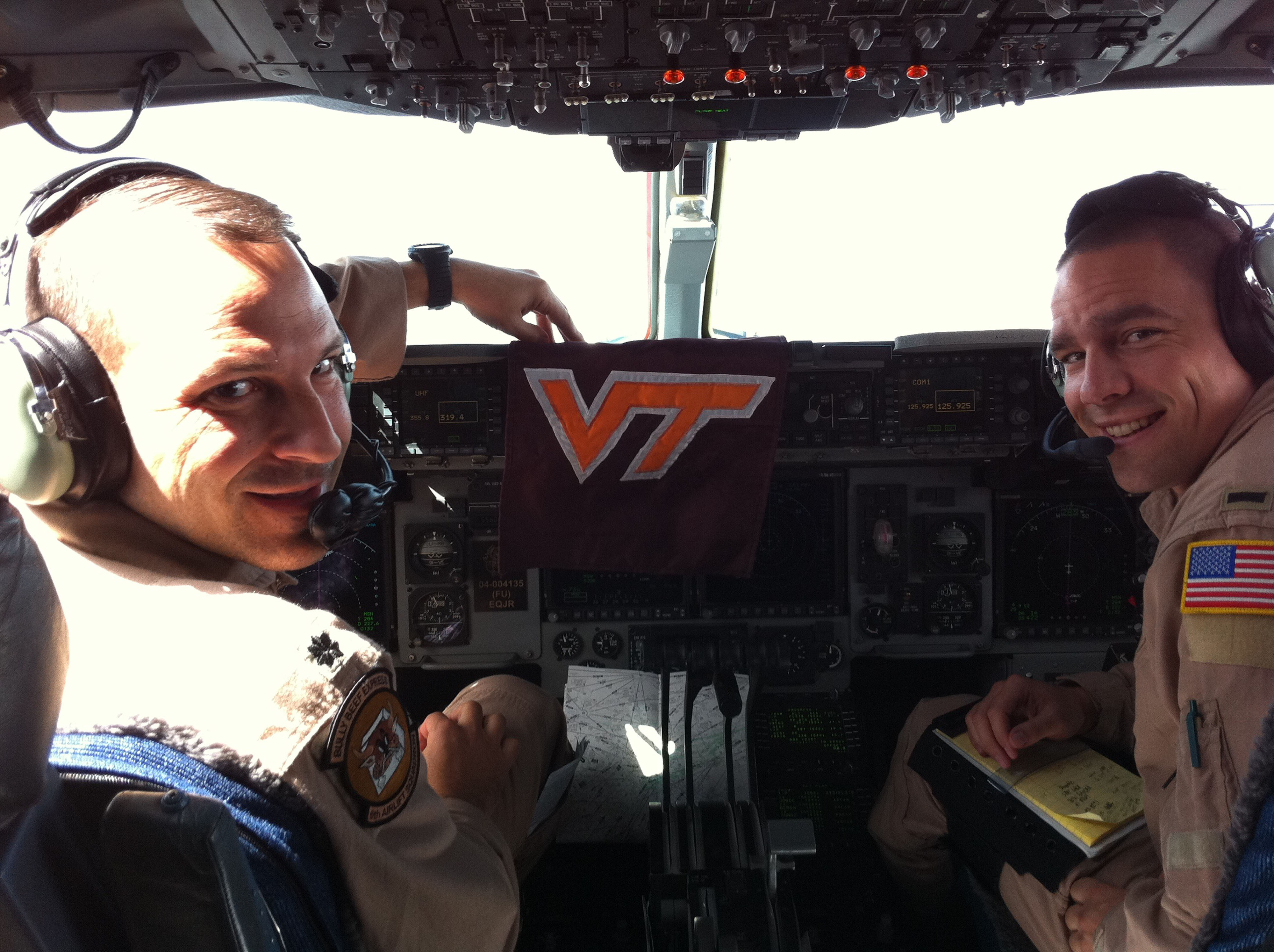 "Lt. Col. Doug Hall (left), U.S. Air Force, Virginia Tech Corps of Cadets Class of 1992 and 1st. Lt. Purvis ""PC"" Gaddis (right), U.S. Air Force, Virginia Tech Corps of Cadets Class of 2009 shown in early September returning from Europe, flying the C-17A Globemaster III that they will bring to Virginia Tech for the Arkansas State game"