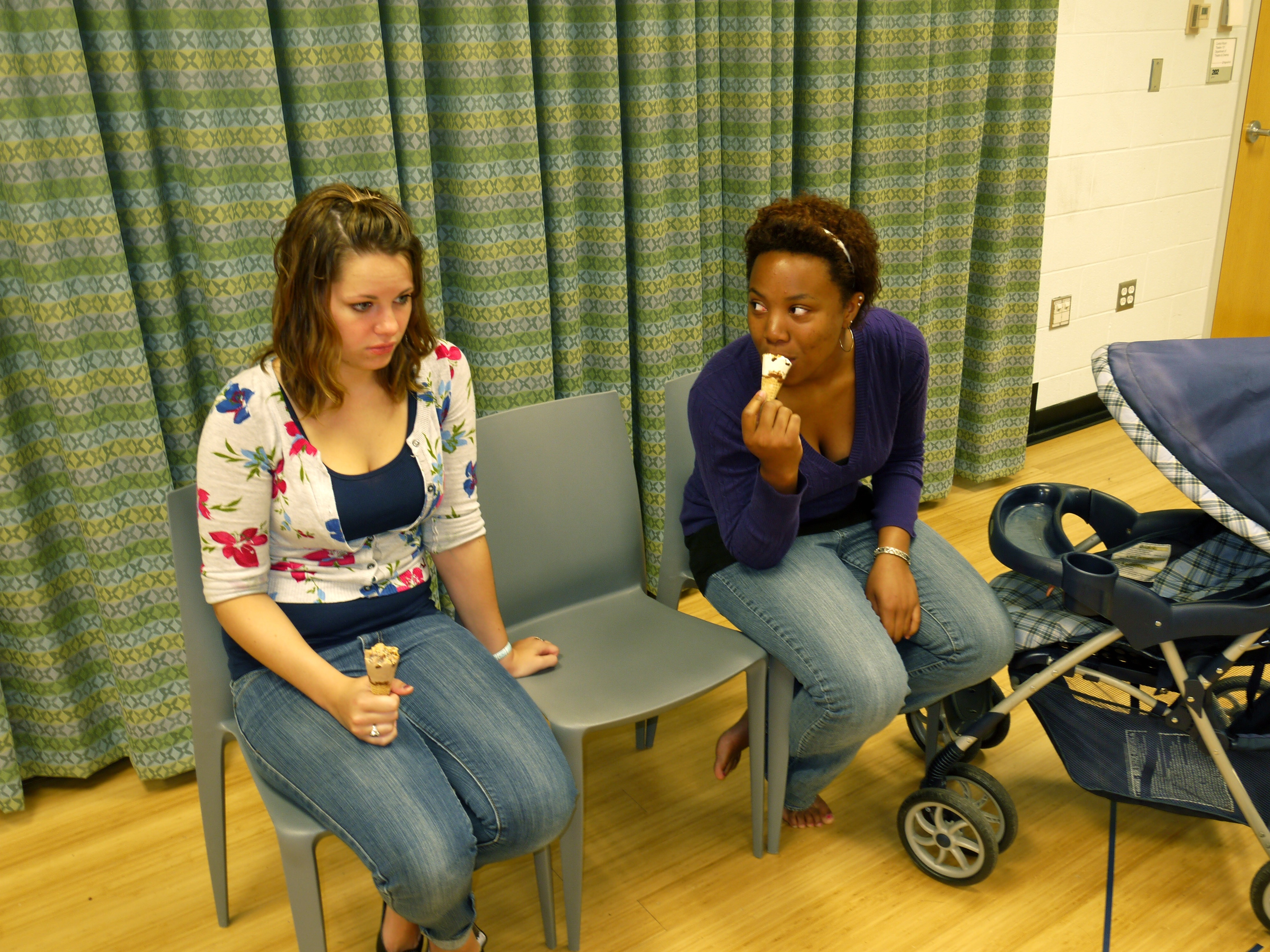 Alexis Demetra Baker (right) and Kristian Yelverton sit in chairs with ice cream cones.