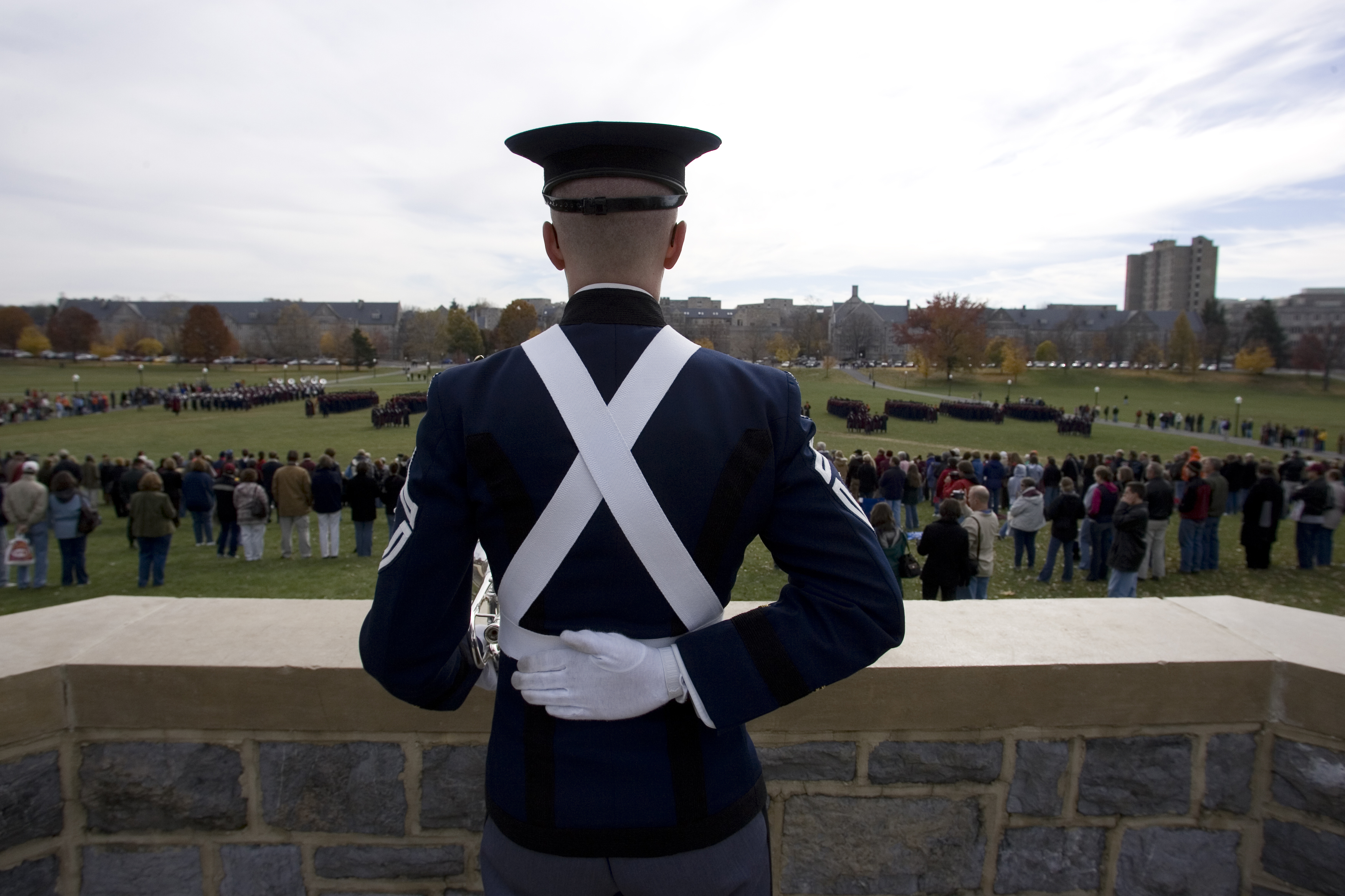 A cadet watches marching formations from the War Memorial