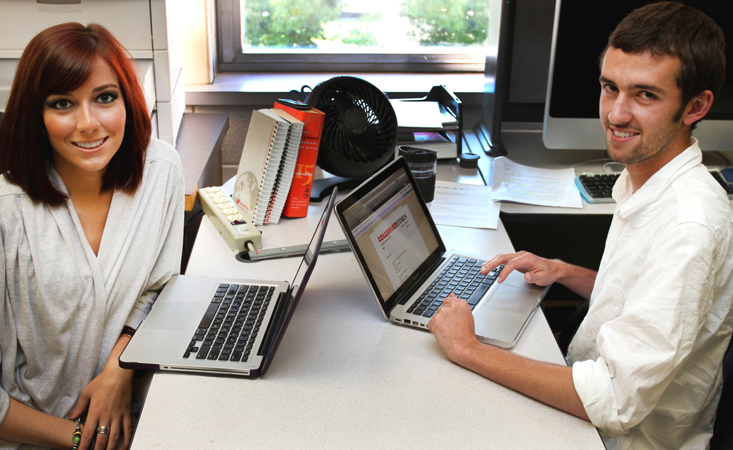 Collegiate Times Managing Editor Lindsey Brookbank and Editor-In-Chief Zach Crizer together in the newspaper's office.
