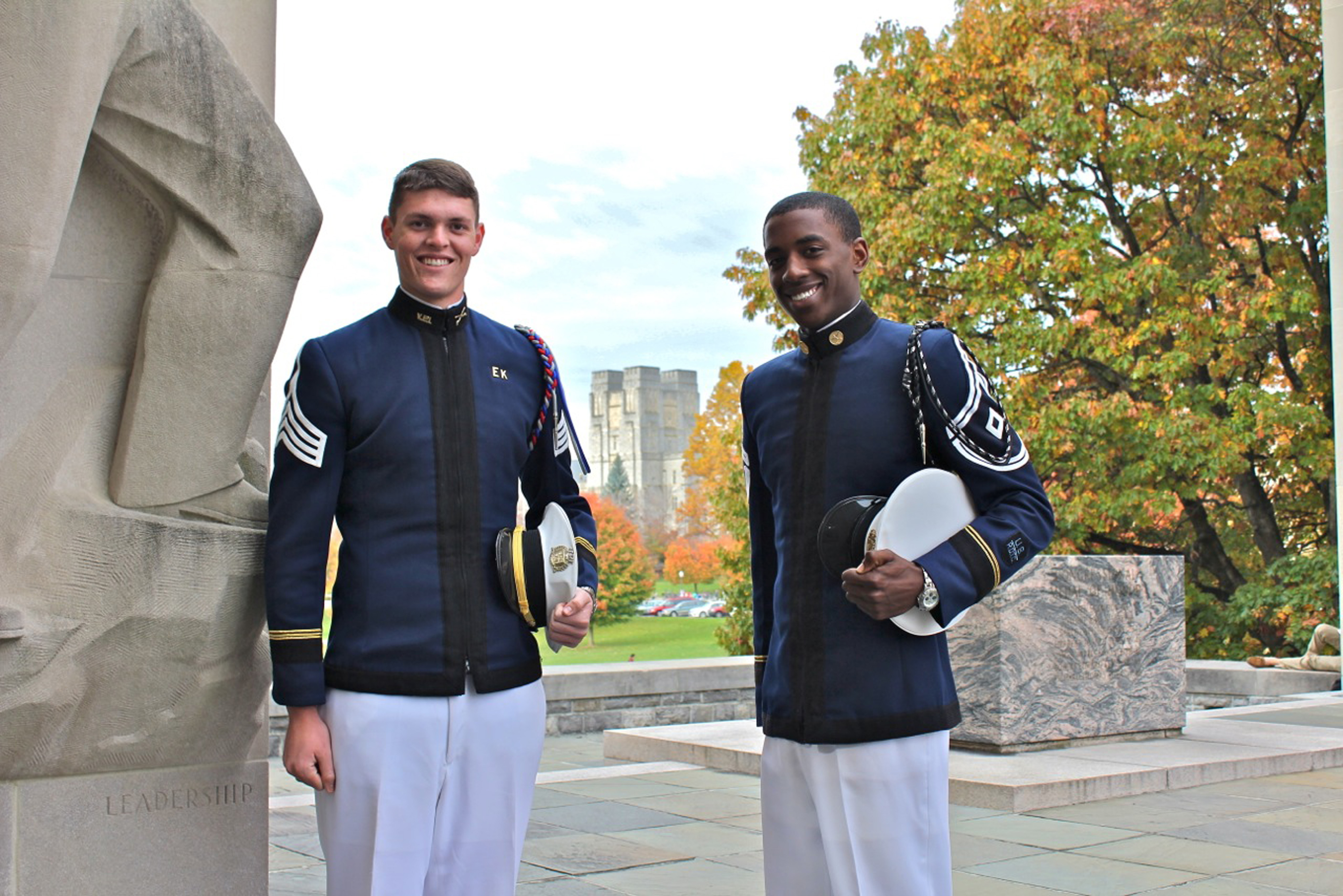 From left to right are Cadets James Harvey and Luke Carpenter standing at the War Memorial
