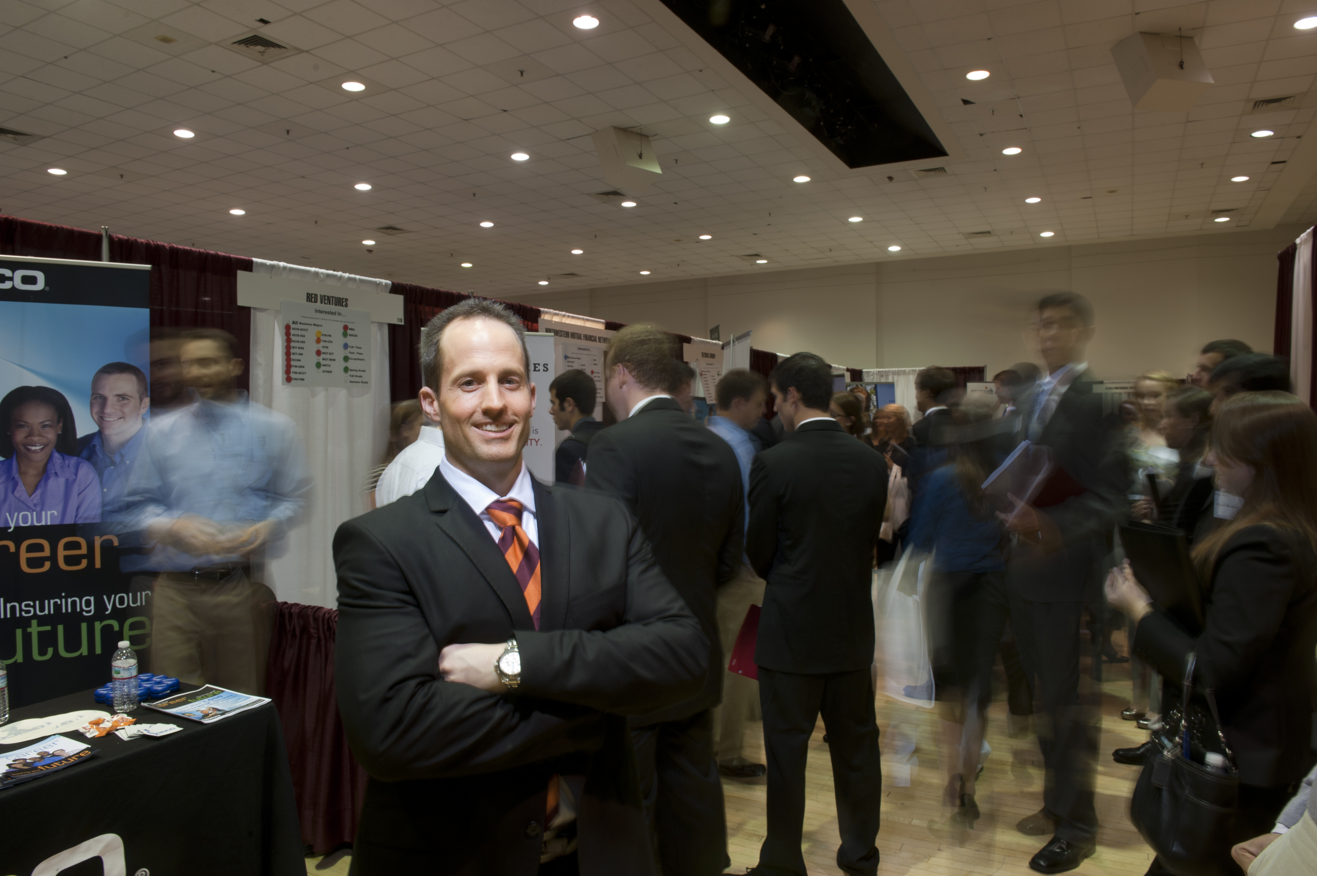 Jason Messer among employer booths at the Business Horizons career fair last month.
