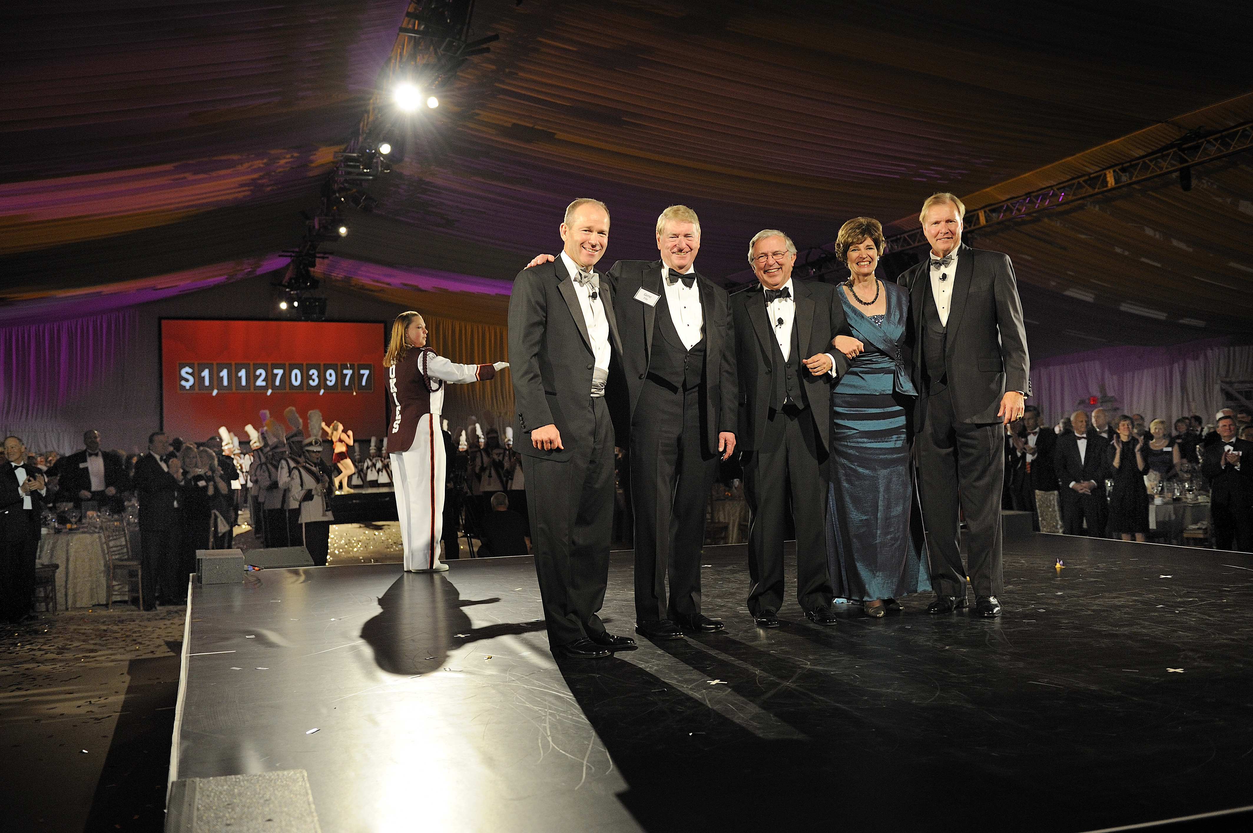 (From left) David Calhoun, Gene Fife, Virginia Tech President Charles W. Steger, Elizabeth Flanagan, and John Lawson appear before the screen that revealed the total amount raised during The Campaign for Virginia Tech: Invent the Future.