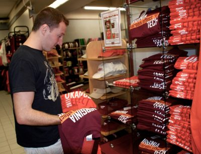 A student studies the 2011 Orange and Maroon Effect shirts.
