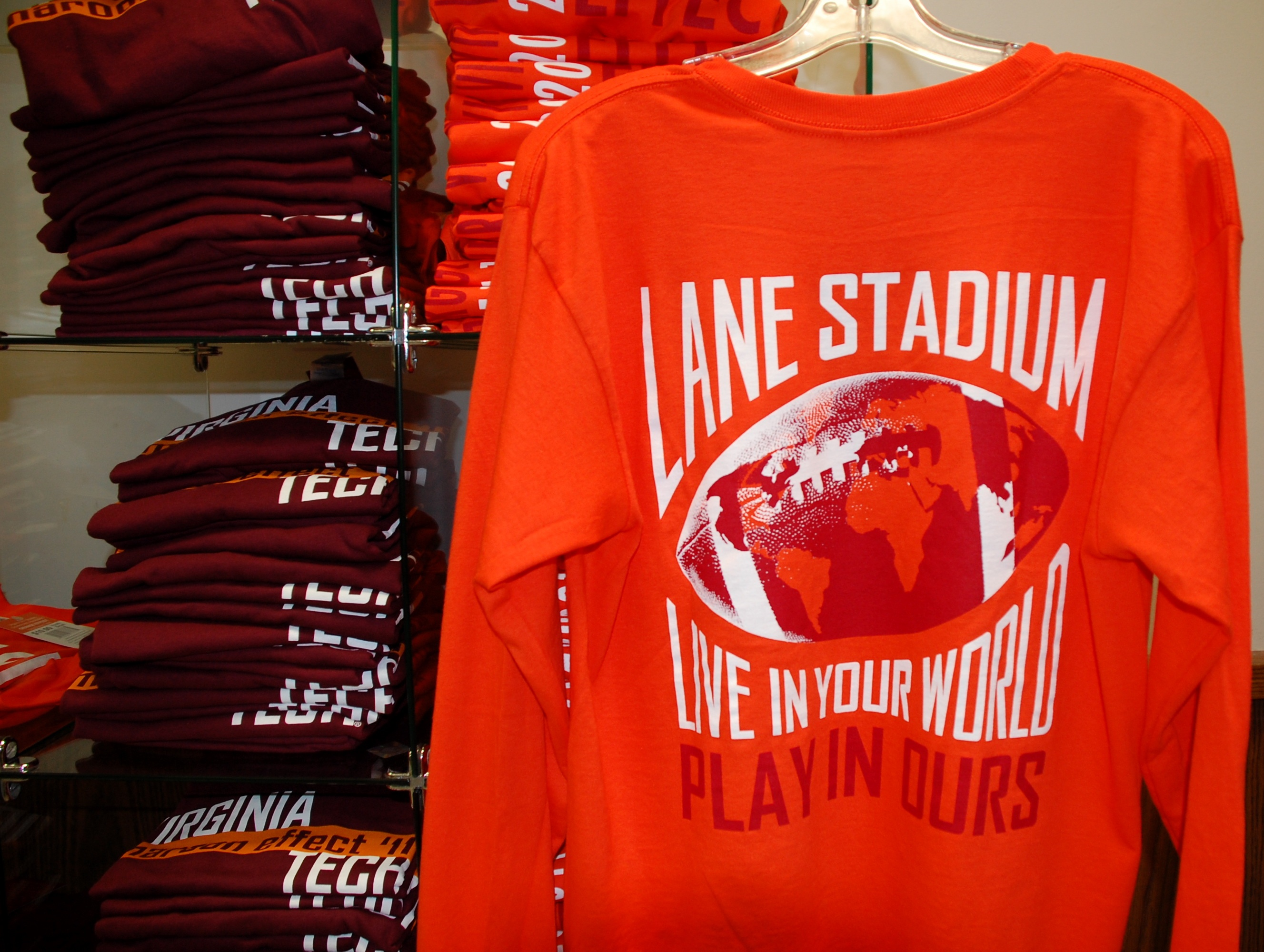 Maroon and Orange Effect shirts on display at Dietrick Convenience Store